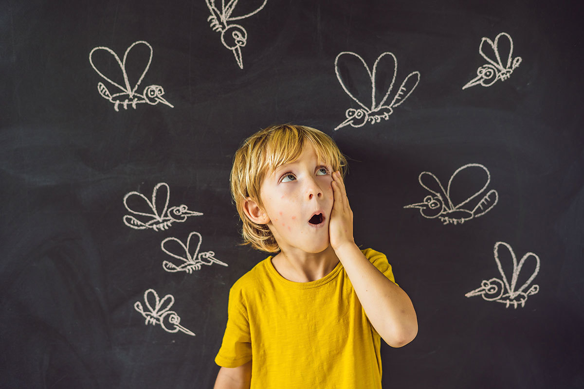 child surrounded by mosquitoes drawn on a chalkboard